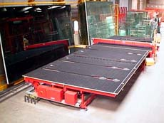 Laminated glass cutting line with 6 moveable glass racks - CNC controlled position stops including break-out display